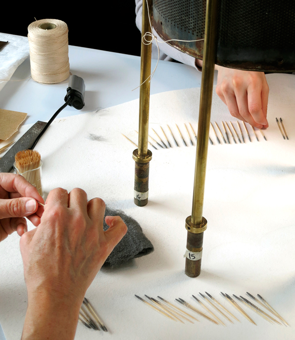 Conservators make swab-like tools out of steel wool and toothpicks to clean corrosion.